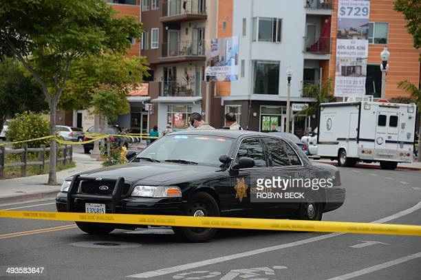 Deputies from the Santa Barbara County Sheriff's office guard a crime scene on May 24, 2014 in Isla Vista, California, a beach community next to the...