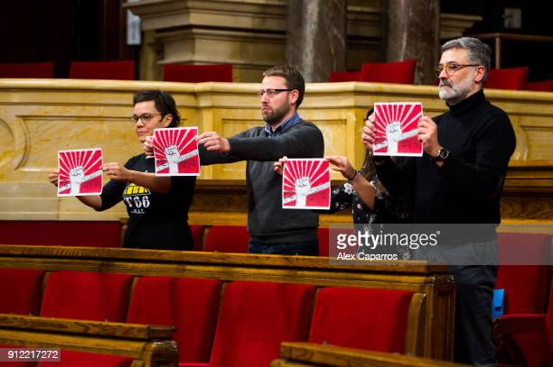 Deputies of Proindependence leftwing Party Candidatura d'Unio Popular CUP protest from their seats at the Parliament of Catalonia on January 30 2018...