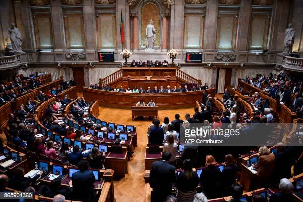 Deputies of Socialist party and left wing parties PCP and Bloco de Esquerda stand to vote against the censure motion tabled by the conservative party...