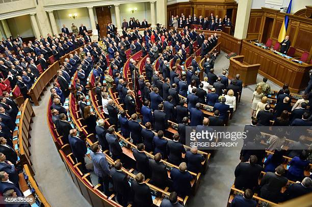 Deputies of the new Ukrainian parliament take the oath of office during the opening of a session in Kiev on November 27 2014 Ukraine's parliament...