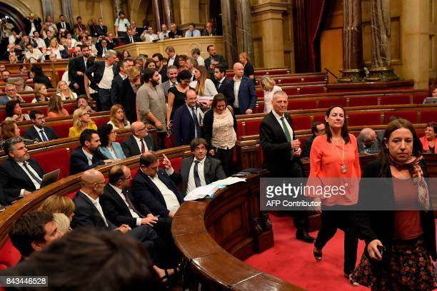 Deputies of the Spanish Socialist Party Partido Popular and Ciutadan's leave the Catalan Parliament before the vote on a bill for a referendum on...