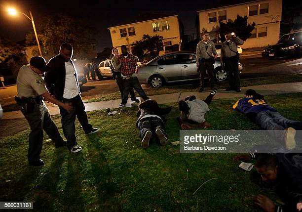 Deputies search and interview suspects after a neighbor called to report hearing 8–10 gun shots on the street in Compton May 28 2010 Almost 10 years...
