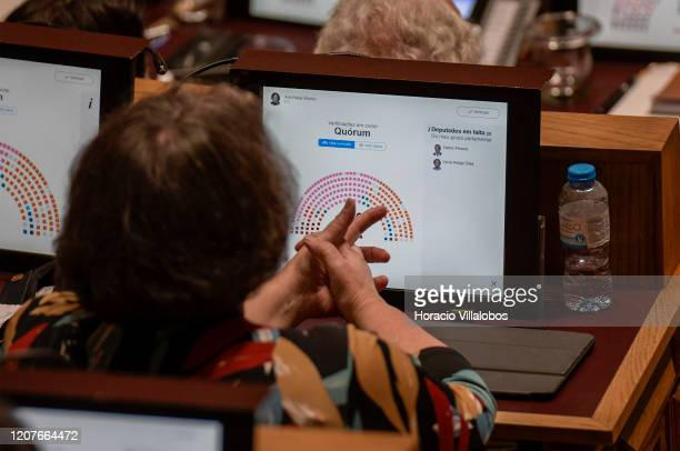 Deputies sit before their screens showing the number of present in the hemicycle at the Assembleia da Republica before voting during the debate in...