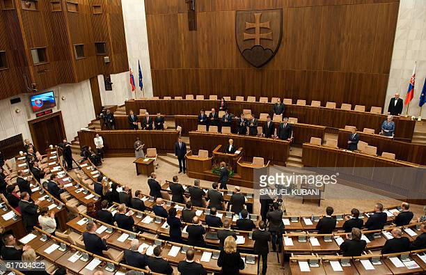 Deputies stand after Slovak Prime Minister-elect and leftist Smer-Social Democracy party leader Robert Fico took the oath of office on the Slovak...