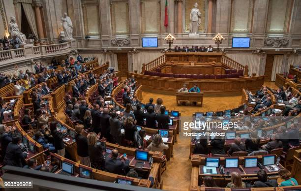 Deputies who have voted against euthanasia legislation stand up and applaud at the end of the debate in the Portuguese Parliament on May 29 2018 in...