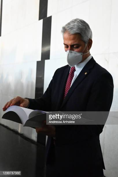 Deputy Alessandro Molon , leader of the oppositionin the Lower House, reads the request to open the impeachment process during a press conference at...