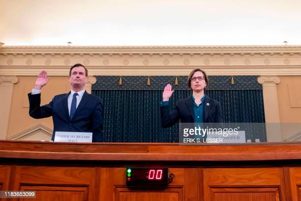 Deputy Assistant Defense Secretary Laura Cooper and Undersecretary of State for Political Affairs David Hale are sworn in before their testimony...