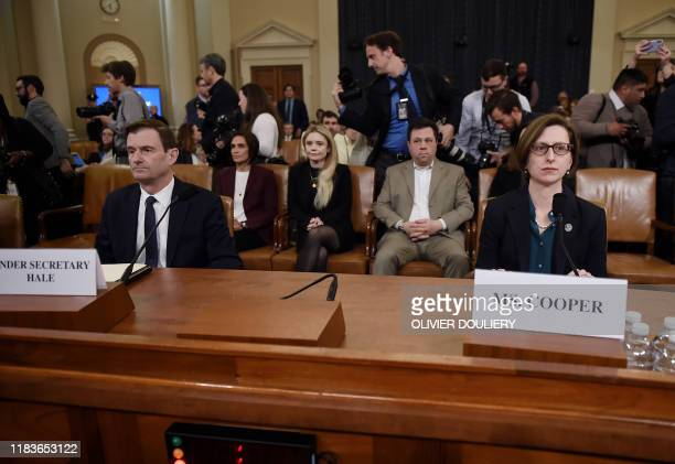 Deputy Assistant Defense Secretary Laura Cooper and Undersecretary of State for Political Affairs David Hale arrive to testify before the House...