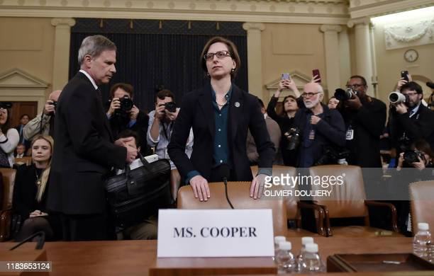 Deputy Assistant Defense Secretary Laura Cooper arrives to testify before the House Intelligence Committee impeachment inquiry on Capitol Hill in...
