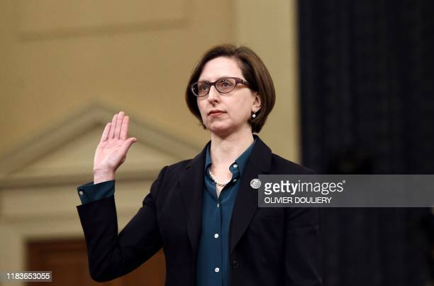 Deputy Assistant Defense Secretary Laura Cooper is sworn in before her testimony before the House Intelligence Committee impeachment inquiry on...