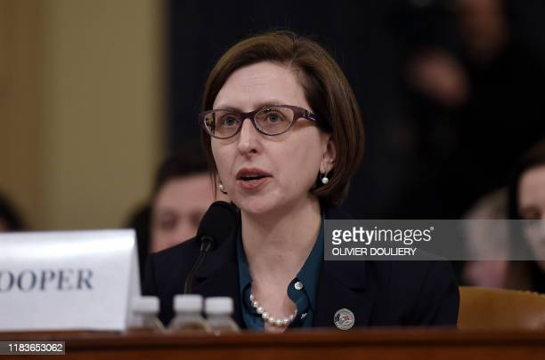 Deputy Assistant Defense Secretary Laura Cooper testifies before the House Intelligence Committee impeachment inquiry on Capitol Hill in Washington...