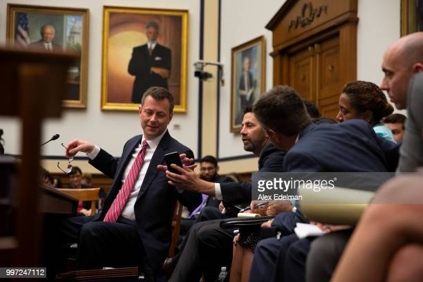 Deputy Assistant FBI Director Peter Strzok confers with his legal counsel on July 12 2018 in Washington DC Strzok testified before a joint committee...
