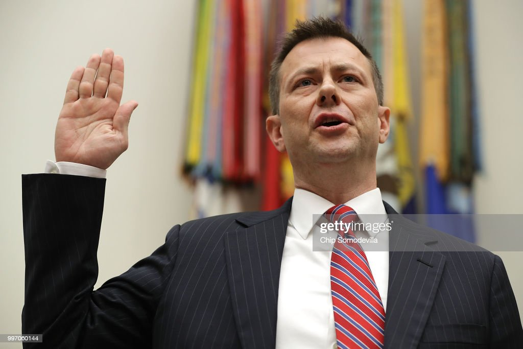 Deputy Assistant FBI Director Peter Strzok is sworn in before a joint committee hearing of the House Judiciary and Oversight and Government Reform committees in the Rayburn House Office Building on Capitol Hill July 12, 2018 in Washington, DC. While involved in the probe into Hillary Clinton's use of a private email server in 2016, Strzok exchanged text messages with FBI attorney Lisa Page that were critical of Trump. After learning about the messages, Mueller removed Strzok from his investigation into whether the Trump campaign colluded with Russia to win the 2016 presidential election.