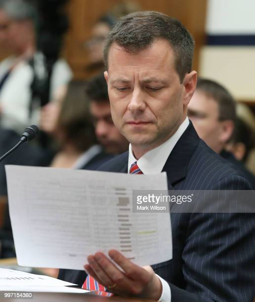 Deputy Assistant FBI Director Peter Strzok looks at a paper handed to him during a joint committee hearing of the House Judiciary and Oversight and...