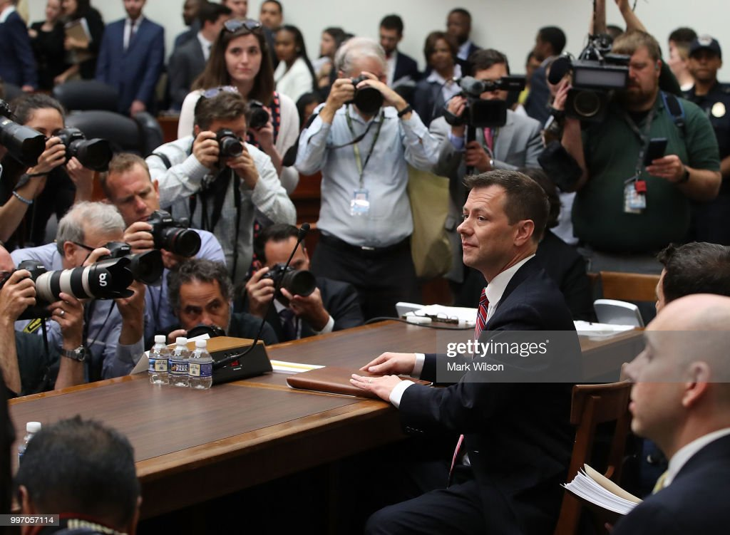 Deputy Assistant FBI Director Peter Strzok waits to testify before a joint committee hearing of the House Judiciary and Oversight and Government Reform committees in the Rayburn House Office Building on Capitol Hill July 12, 2018 in Washington, DC. While involved in the probe into Hillary Clinton's use of a private email server in 2016, Strzok exchanged text messages with FBI attorney Lisa Page that were critical of Trump. After learning about the messages, Mueller removed Strzok from his investigation into whether the Trump campaign colluded with Russia to win the 2016 presidential election.Ê