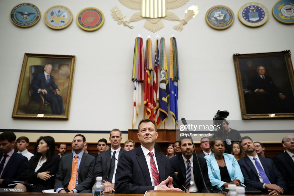 Deputy Assistant FBI Director Peter Strzok (C) waits to testify before a joint committee hearing of the House Judiciary and Oversight and Government Reform committees in the Rayburn House Office Building on Capitol Hill July 12, 2018 in Washington, DC. While involved in the probe into Hillary Clinton's use of a private email server in 2016, Strzok exchanged text messages with FBI attorney Lisa Page that were critical of Trump. After learning about the messages, Mueller removed Strzok from his investigation into whether the Trump campaign colluded with Russia to win the 2016 presidential election.