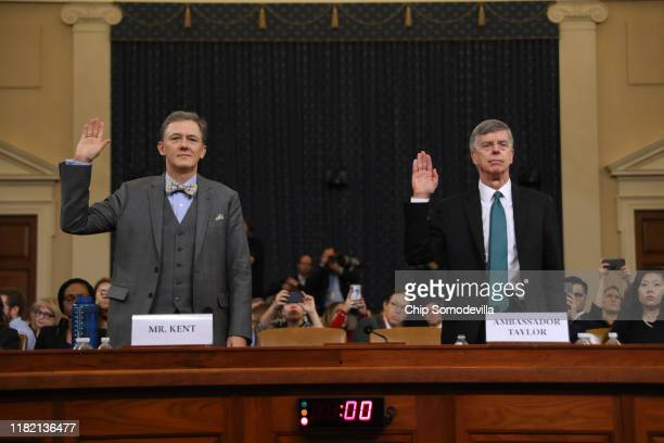 Deputy Assistant Secretary for European and Eurasian Affairs George P Kent and top US diplomat in Ukraine William B Taylor Jr are sworn in before...