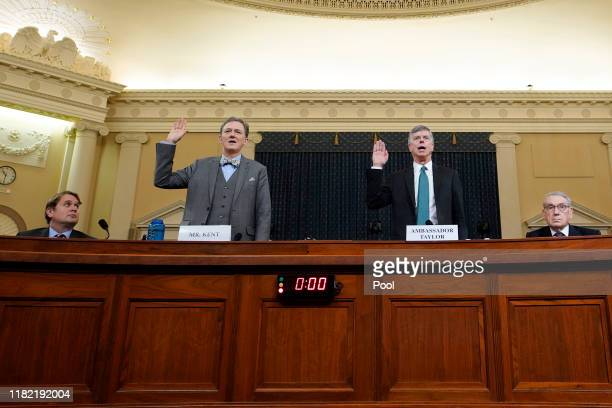 Deputy Assistant Secretary for European and Eurasian Affairs George P Kent and top US diplomat in Ukraine William B Taylor Jr are swornin prior to...