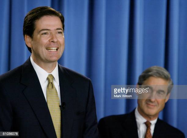 Deputy Attorney General James B. Comey announces indictment of the former Enron CEO, Kenneth Lay, while FBI Director Robert Mueller listens July 8,...