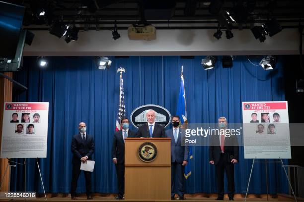 Deputy Attorney General Jeffery Rosen speaks to the media about charges and arrests related to a computer intrusion campaign tied to the Chinese...