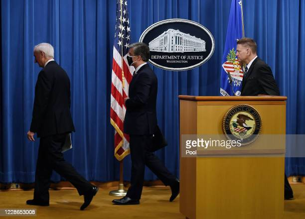S Deputy Attorney General Jeffrey A Rosen FBI Director Christopher Wray and Drug Enforcement Agency acting Administrator Timothy Shea leave after a...