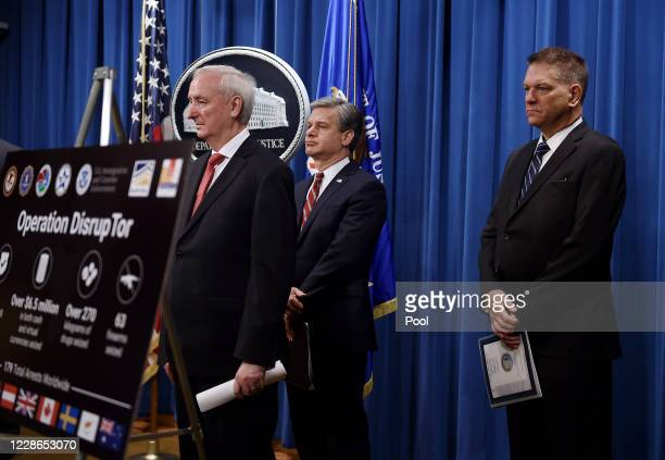 S Deputy Attorney General Jeffrey A Rosen FBI Director Christopher Wray and Drug Enforcement Agency acting Administrator Timothy Shea hold a news...