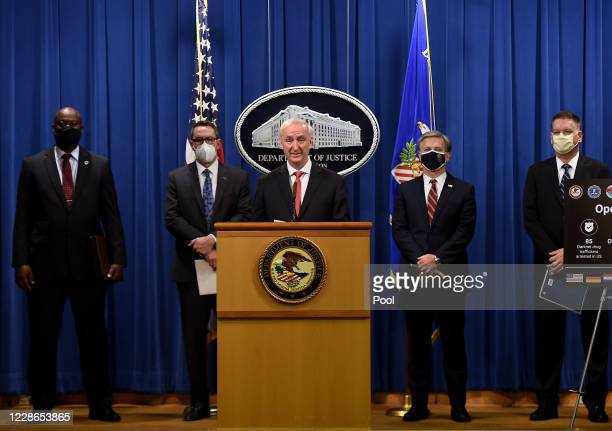 S Deputy Attorney General Jeffrey A Rosen speaks as Chief Postal Inspector Gary Barksdale Immigration and Customs Enforcement acting Deputy Director...