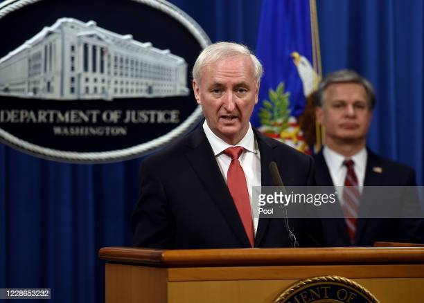S Deputy Attorney General Jeffrey A Rosen speaks as FBI Director Christopher Wray looks on at a news conference at the Justice Department on...