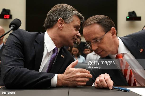S Deputy Attorney General Rod Rosenstein and FBI Director Christopher Wray talk prior to a hearing before the House Judiciary Committee June 28 2018...