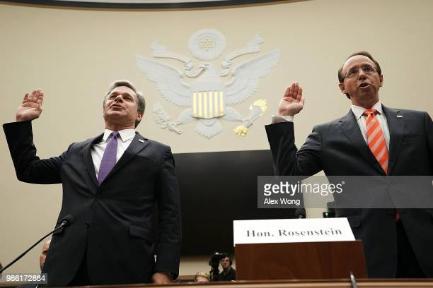 S Deputy Attorney General Rod Rosenstein and FBI Director Christopher Wray are sworn in during a hearing before the House Judiciary Committee June 28...