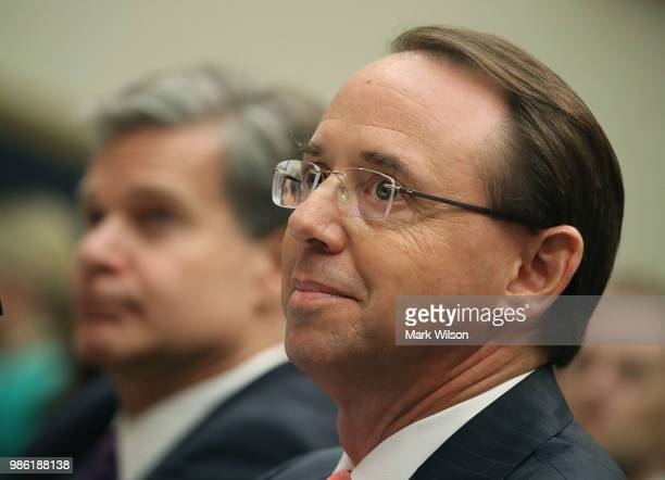 S Deputy Attorney General Rod Rosenstein and FBI Director Christopher Wray testify during a House Judiciary Committee hearing June 28 2018 on Capitol...