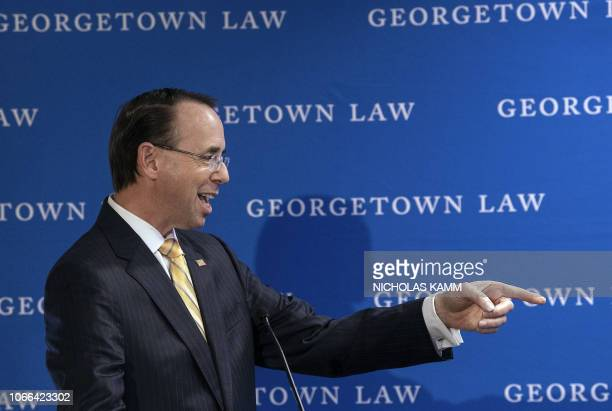 US Deputy Attorney General Rod Rosenstein jokes with the moderator as he addresses a symposium titled 'Cybercrime 2020 Revisiting the Future of...