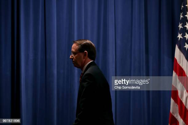 S Deputy Attorney General Rod Rosenstein leaves a news conference at the Department of Justice July 13 2018 in Washington DC Rosenstein announced...