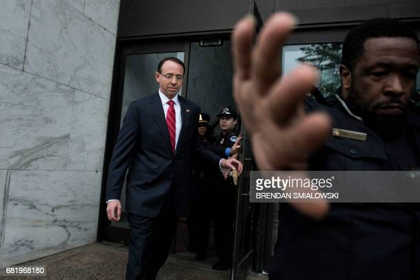 Deputy Attorney General Rod Rosenstein leaves after a closed meeting with Senate Intelligence Committee senior members Senator Richard Burr and...