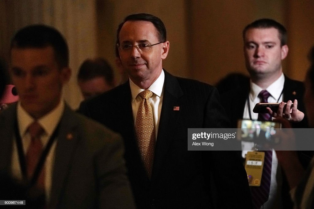 Deputy Attorney General Rod Rosenstein (C) leaves the U.S. Capitol after a meeting with House Speaker Paul Ryan (R-WI) January 3, 2018 in Washington, DC.