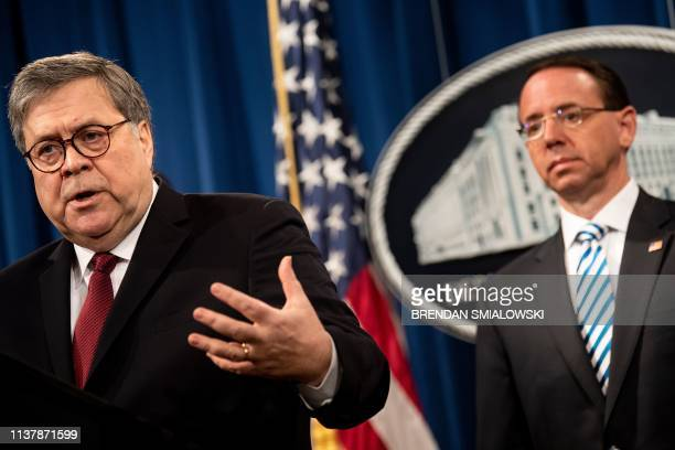 US Deputy Attorney General Rod Rosenstein listens while Attorney General William Barr speaks during a press conference about the release of the...