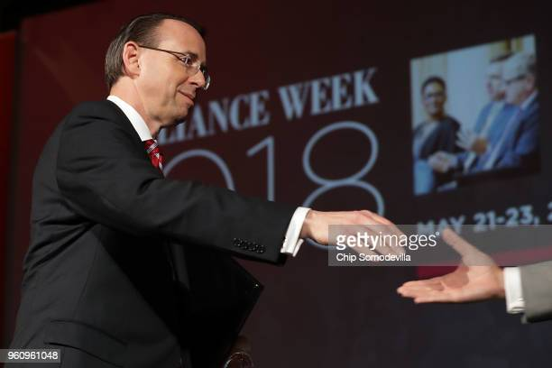 S Deputy Attorney General Rod Rosenstein shakes hands with Stephen Cohen of Sidley Austin LLP after delivering remarks on 'Justice Department Views...