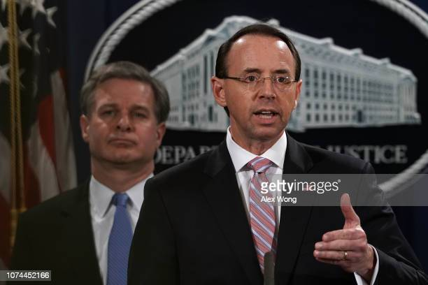 S Deputy Attorney General Rod Rosenstein speaks as FBI Director Christopher Wray listens during a news conference to announce a Chinarelated national...