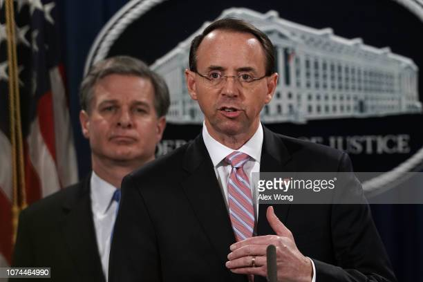 S Deputy Attorney General Rod Rosenstein speaks as FBI Director Christopher Wray listens during a news conference to announce a China related...