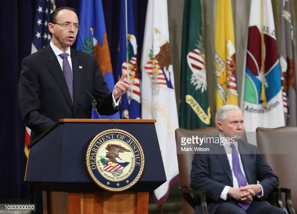 S Deputy Attorney General Rod Rosenstein speaks while Attorney General Jeff Sessions listens during the first National Opioid Summit at the Justice...