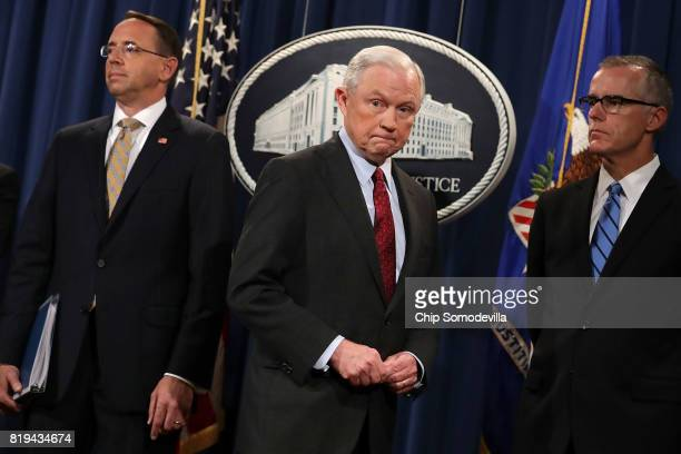 Deputy Attorney General Rod Rosenstein US Attorney General Jeff Sessions Acting FBI Director Andrew McCabe other law enforcement officials hold a...