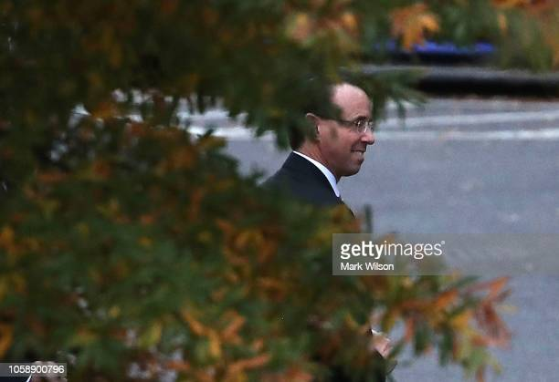 Deputy Attorney General Rod Rosenstein walks to his vehicle after a meeting at the White House on November 7 2018 in Washington DC Earlier in the day...