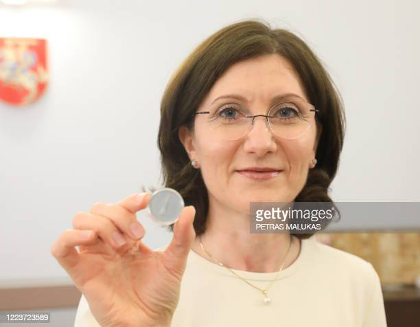 Deputy Chair of the Board of the Bank of Lithuania, Asta Kuniyoshi, holds a 1,5 Euros nominal silver coin, minted to mark the novel coronavirus...