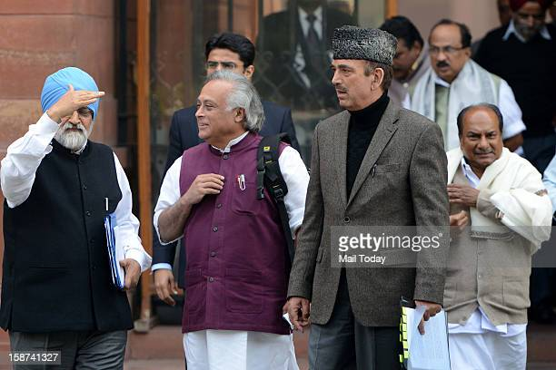 Deputy Chairman of Planning Commission Montek Singh Ahluwalia and Union Ministers Jairam Ramesh Ghulam Nabi Azad and AK Antony leave after a Cabinet...