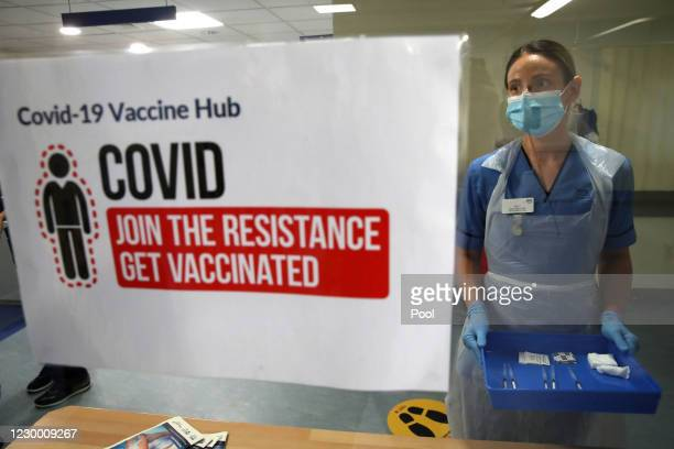 Deputy charge nurse Katie McIntosh waits to administer the first of two Pfizer/BioNTech Covid-19 vaccine jabs to staff at the Western General...