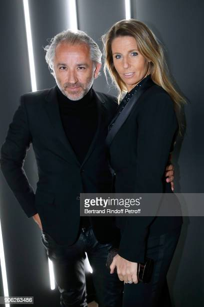 Deputy Chief Executive Officer of L'Oreal Luxe Cyril Chapuy and his wife attend the 'YSL Beauty Hotel' event during Paris Fashion Week Menswear...