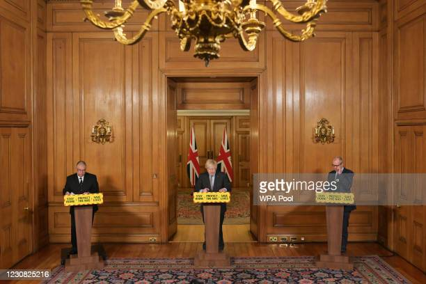 Deputy Chief Medical Officer Jonathan Van-Tam, Prime Minister Boris Johnson and Government Chief Scientific Adviser Patrick Vallance attend a press...