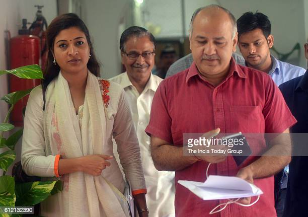 Deputy Chief Minister of Delhi Manish Sisodia with Alka Lamba during One day special session of vidhan sabha in New Delhi