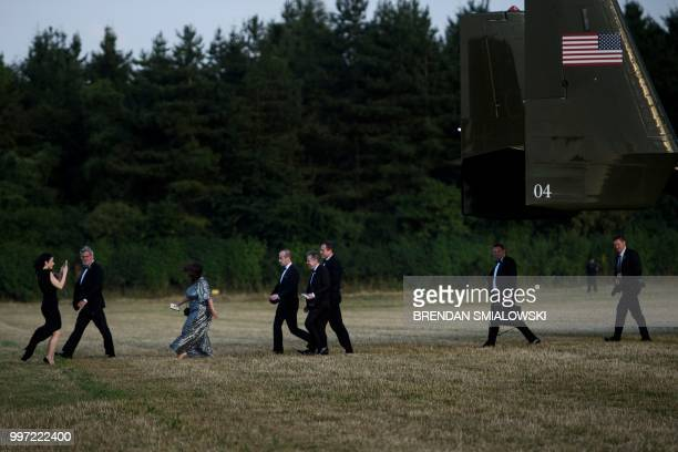Deputy Chief of Staff for Communications Bill Shine Senior Advisor to the President Stephen Miller and others walk from an Osprey to attend a...