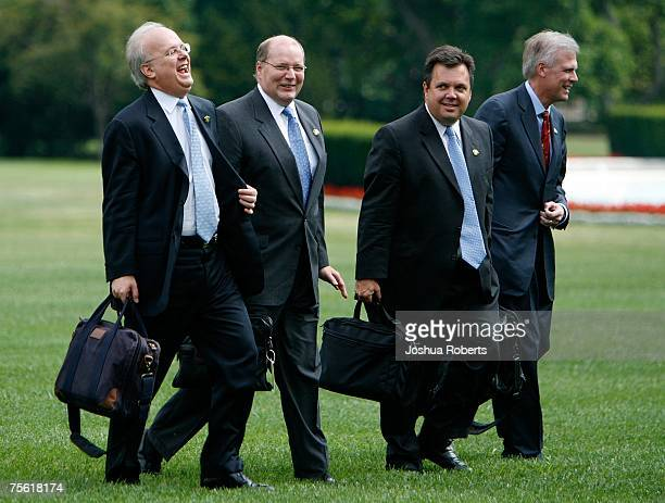 Deputy Chief of Staff Karl Rove laughs with Deputy Chief of Staff Joseph Hagen White House Communications Director Kevin Sullivan and White House...